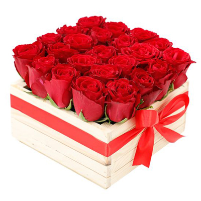 wooden box filled with fresh red roses