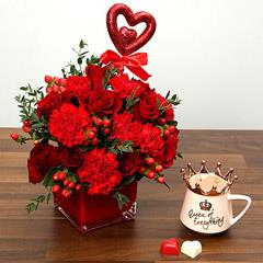 Red Roses and Carnations With A Jar