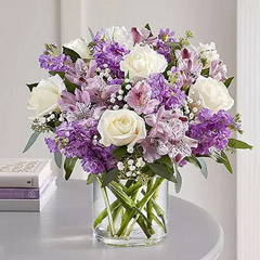 Purple and White Floral Bunch In Glass Vase