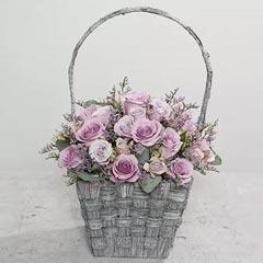 Purple Flowers In Rustic Handle Basket