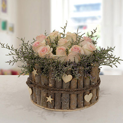 Peach Roses in Wooden Base Arrangement