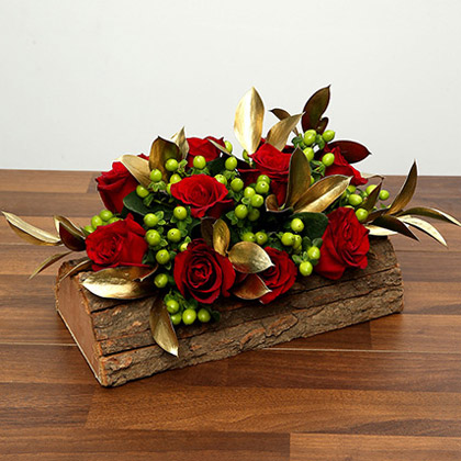 Red Roses In Wooden Base