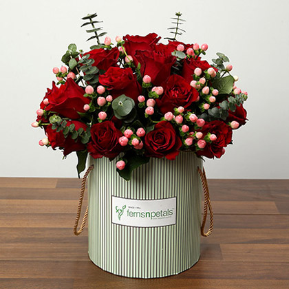Arrangement Of Red Roses and Pink Berries