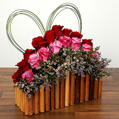 Red and Purple Roses In A Wooden Base
