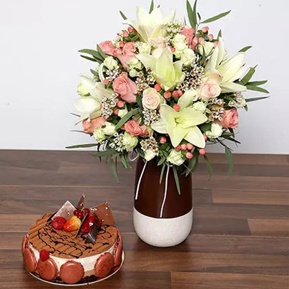 Beautiful White and Peach Flowers In Vase With Cake