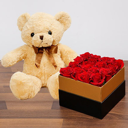 Idyllic Red Roses and Teddy Bear