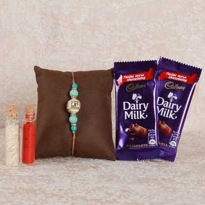 Splendid Rakhi And Chocolates Combo